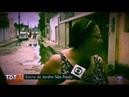 PRESA NO PORTÃO Mulher fica presa no portão eletrônico ao vivo durante entrevista à Globo