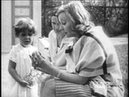 Greta Garbo playing with a child in the garden 1928