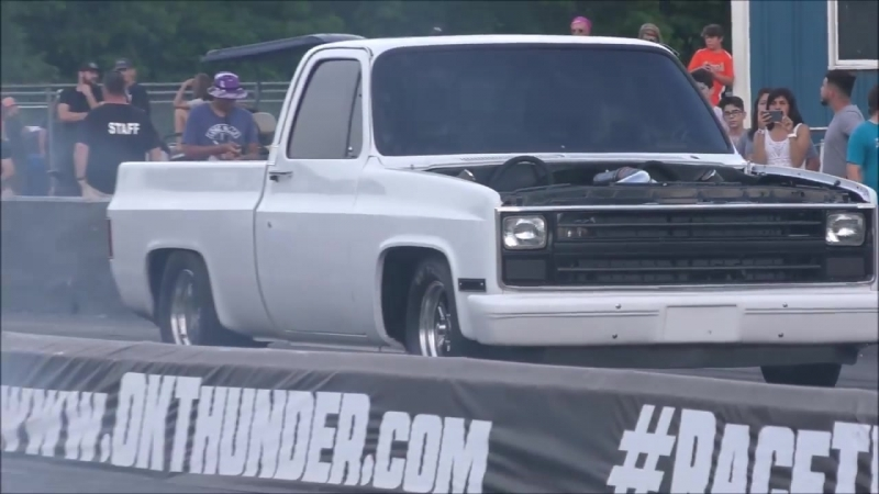 A pair of turbo C10 trucks doing battle in the sct at Thunder Valley