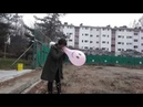 North korean girl blows up a balloon until it pops