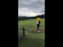 Lad drives golf ball and lets go of club