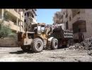 Работники ERT чистят Ракку