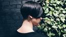 Short women's haircut, triangular and round graduation