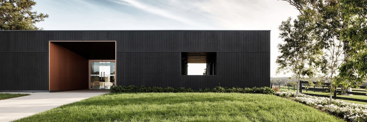 THOSE architects convert former dairy farm into contemporary sales office