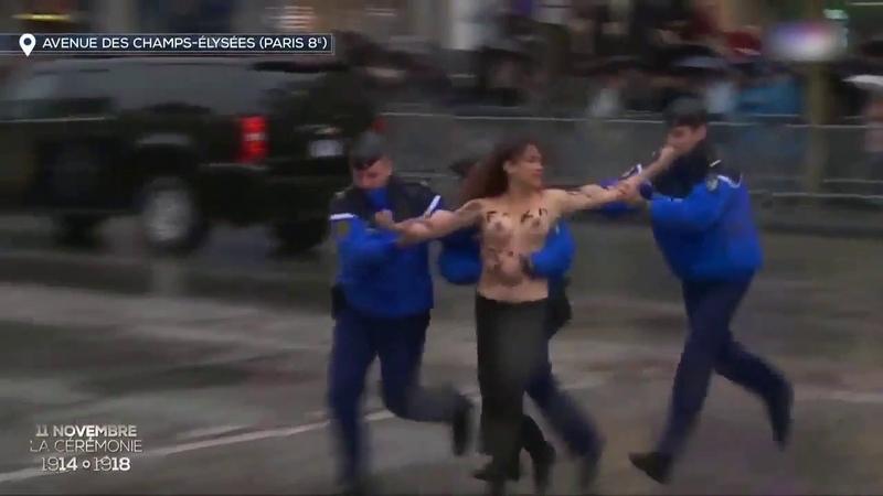 Topless FEMEN protester throws herself at Trump's motorcade in Paris