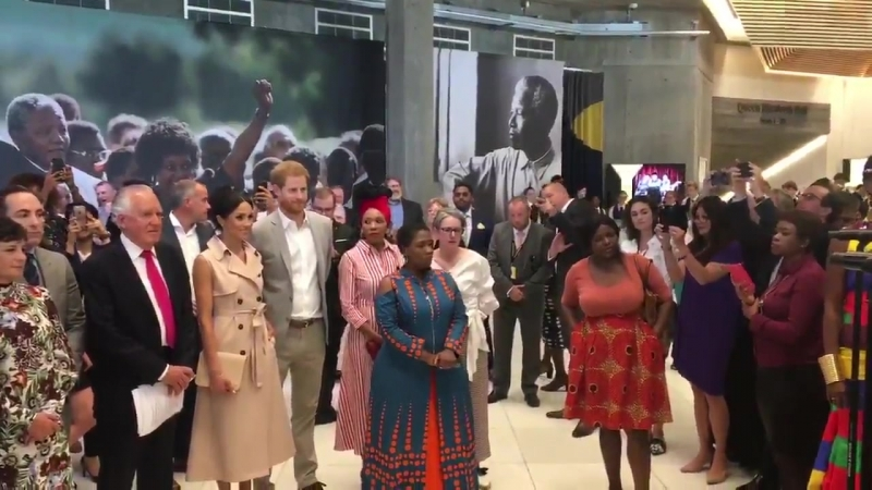 Duke and Duchess of Sussex enjoying a performance by the Ubunye Choir