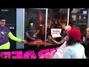 Video Restaurant owner butchers deer leg in front of Vegan protest