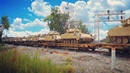 BNSF ES44AC 6251/BNSF Executive SD70MAC 9741 lead W830 loaded military train over the diamond