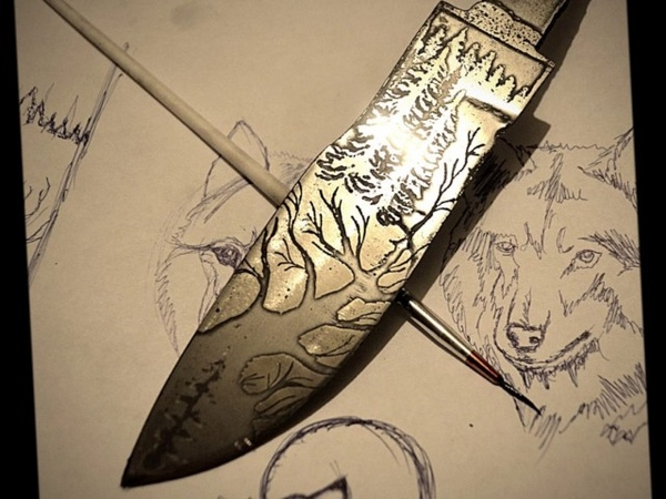 нож с травлением волка из р6м5 the knife is etched with a wolf
