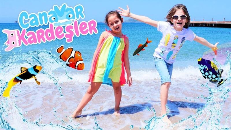 Çocuk oyunları. Oyun alanı - plaj. Canavar Kardeşler denizde balık tutuyorlar