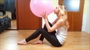 Blowing up a large pink balloon until it almost pops
