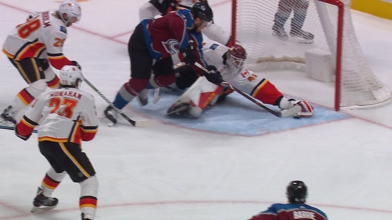 Mike Smith stretches out to rob Gabriel Landeskog with the glove