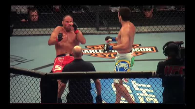 MMA - Lyoto Machida unleashes his inner Karate Kid to deliver a jumping switch front kick (crane kick) to Randy Couture