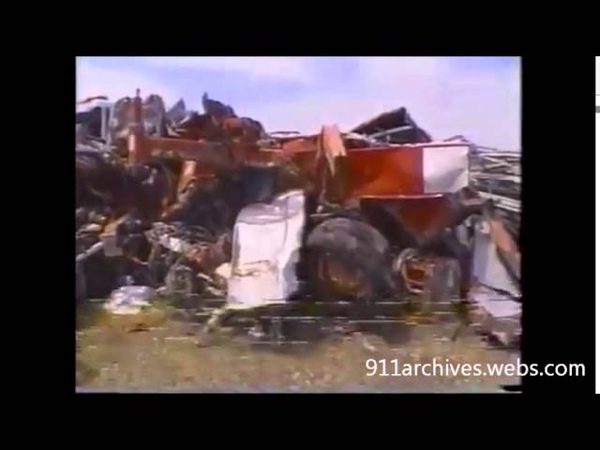 Raw Fresh Kills Landfill in 2002 with destroyed FDNY firetrucks
