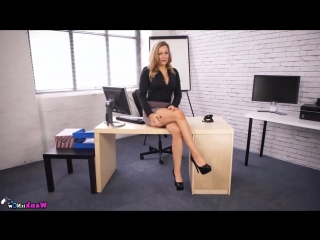 Sexy blonde secretary in mini skirt