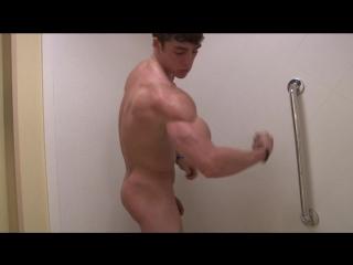 Teen bodybuilder big biceps in shower