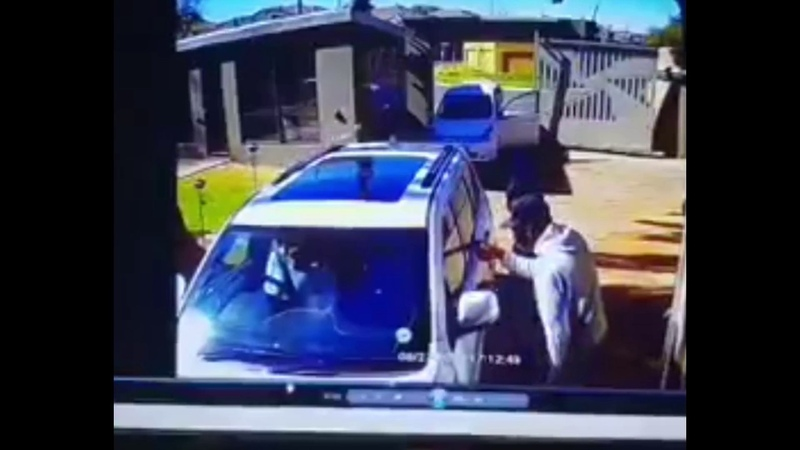 A group of black racist American criminal savages try to carjack a white woman in her own yard. She fights back against the black racist thugs and rams them with her car. Well done, Miss. Lady drives over carjackers car with her Jeep