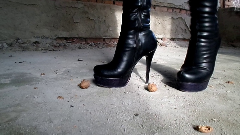 Crush nuts with high heeled boots