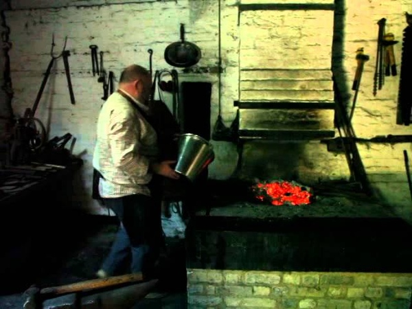 Blacksmith Working a Medieval Forge in UK