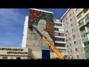 Девушка с кумысом - новое граффити на стене в Костанае