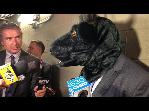 Predators coach Peter Bull Laviolette pays off a bet after Preds beat Oilers