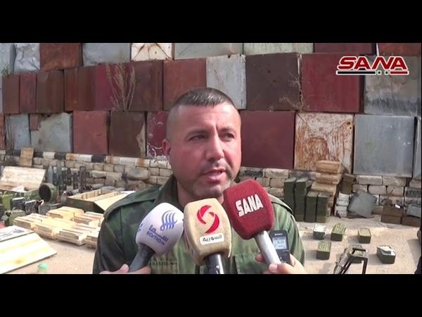 Оружие и боеприпасы, оставленные террористами на плантациях Дараа Аль-Баляд