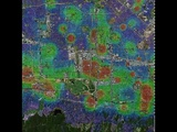 Reaction-diffusion modelling of crime hotspots in a real map of a city