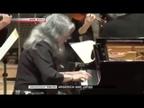 Lovely Martha Argerich mistakes microphone for mobile phone