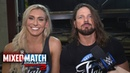 Charlotte Flair AJ Styles engage in a post-match Woo-off