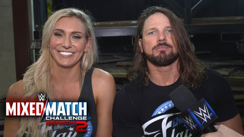Charlotte Flair AJ Styles engage in a post match Woo off