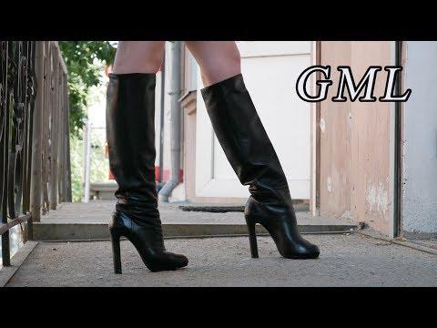 Christinas stylish black leather boots, high heels Gianmarco Lorenzi.