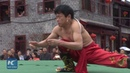 Shrinking body to squeeze into small loop: Kung Fu display in SW China