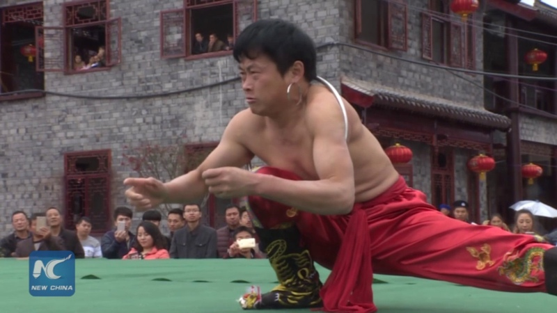 Shrinking body to squeeze into small loop Kung Fu display in SW China