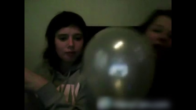 Two girls do the balloon challenge blow to pop on old webcam
