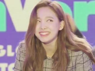 Jeongyeon pinching nayeon's cheek and her reaction right after