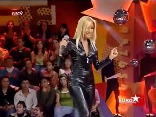 Zeynep Mansur in black PVC catsuit