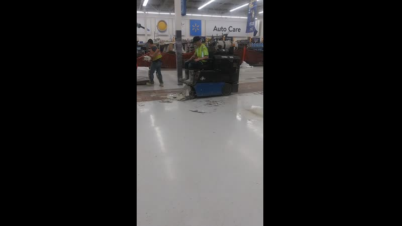 Walmart Remodel Crew with a drivable tile scraper