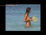 Candid Milf mom naked on the nude beach with her son