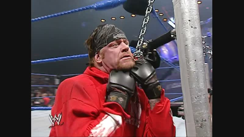 WWE.SmackDown.2003.10.16 - Brock Lesnar The Undertaker brawl with the use of a biker chain