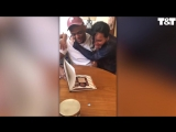 Girl-Surprises-Stepdad-With-Photo-Book-Adoption-Gift