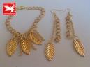 Pendientes de moda dorados con cadenas y hojas golden earrings with chains and leaves