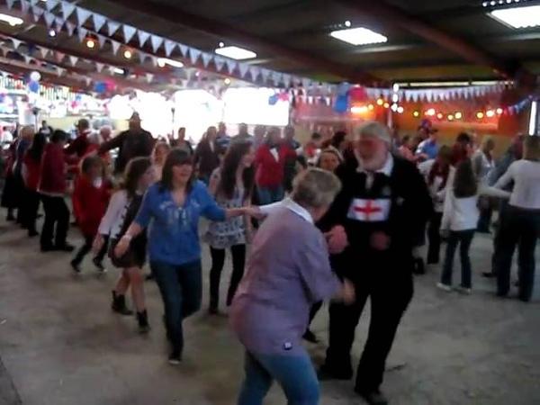 Dancing the traditional English Folk Dance: 'Farmer's Jig' at a Royal Wedding Party