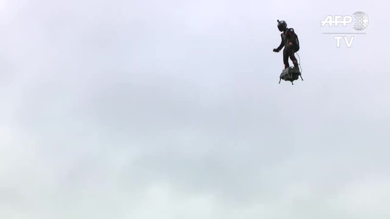 A flying man over the Champs-Elysees at Paris parade _ AFP