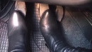 Women car cranking and feet in black boots gas pedal pumping. 9412