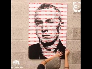 Художник нарисовал картину с Eminem'om, состоящую из бэйджиков с надписью
