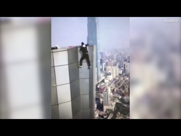 Shocking moment Chinese daredevil falls to his death