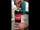 Smuggling drugs into prison using a Coke bottle