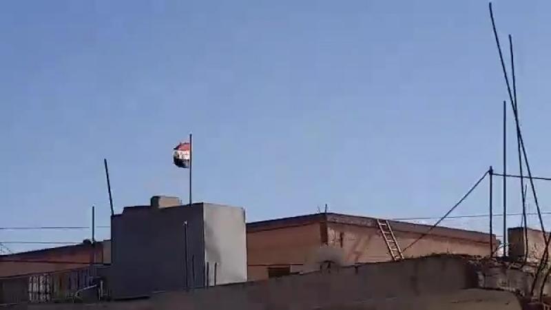 Syria State flags raised in Busra al Harir