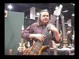 Randy Strom playing and AngelWarr guitar at Winter NAMM 2002.