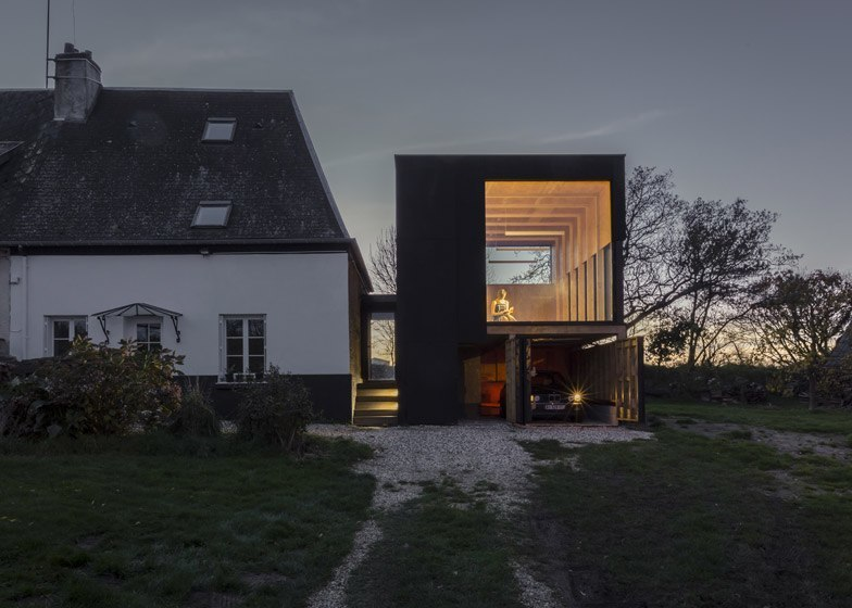 Blackened timber reading room extends a coastal home in northern France /  Antonin Ziegler / Photography is by Antonin Ziegler